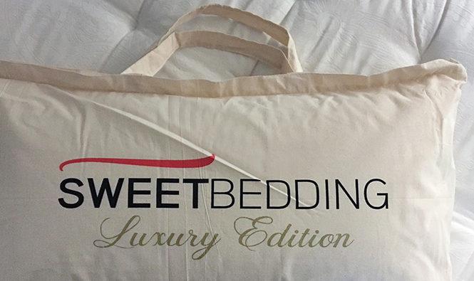 Funda de la almohada Sb Memory con el logo de Sweetbedding.